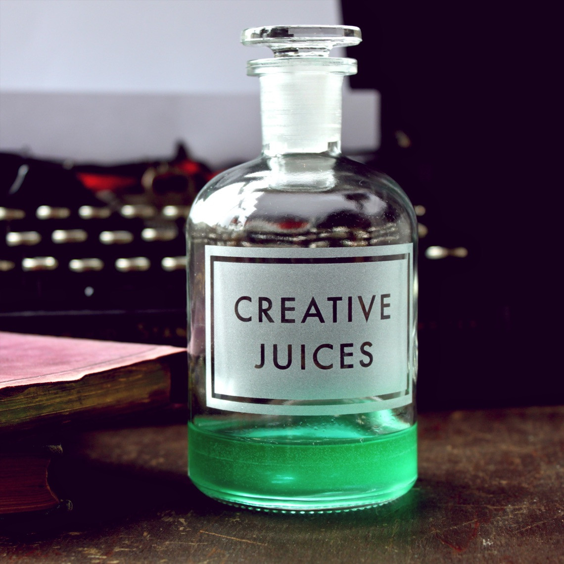 creative juices bottle vinegar & brown paper