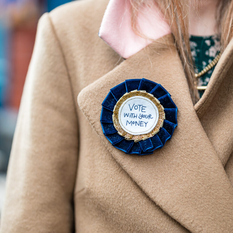 Vote with your money campaign rosette