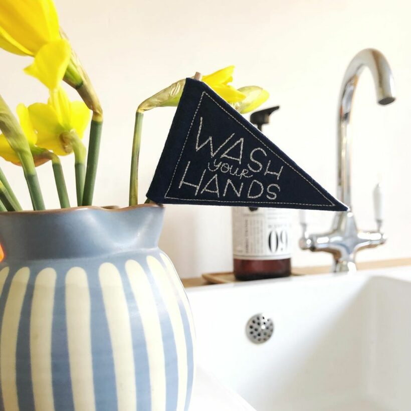 Wash your hands embroidered flag by Emma Giacalone