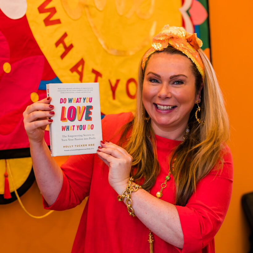 Holly Tucker, MBE Holding her book, Do What You Love, Love What You Do